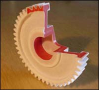 Gear wheel in which the skin material has a low friction and great wear resistance